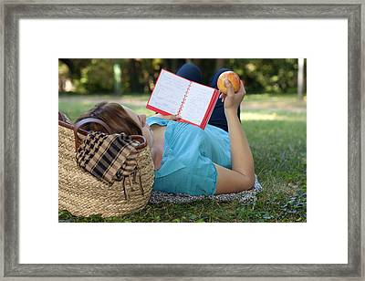 Studying Outdoors Framed Print by Boyan Dimitrov