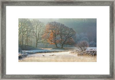 stunning winter light on the river Brathay Framed Print