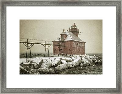 Sturgeon Bay Pierhead Storm Framed Print by Joan Carroll