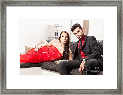 Stylish Young Couple On A Couch Framed Print