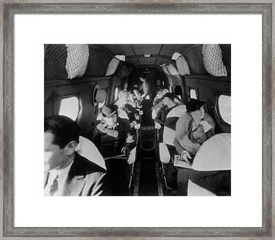 Stylishly Dressed Passengers Seated Framed Print