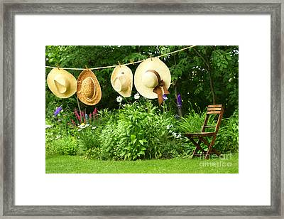 Summer Straw Hats Hanging On Clothesline Framed Print by Sandra Cunningham