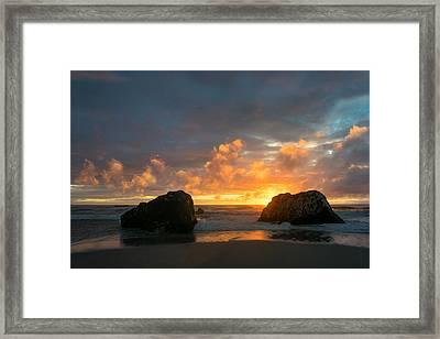 Sun And Rocks Framed Print