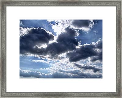 Sun Breaking Through The Clouds Framed Print
