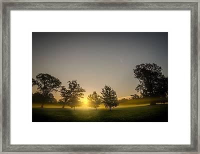 Sun Breaks Over Mist And Fog Framed Print