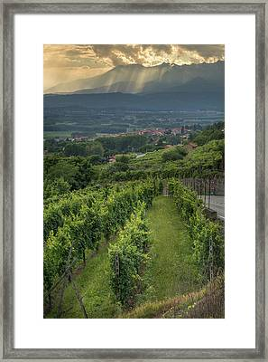 Sun Filtering Through The Clouds  Framed Print