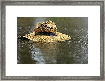 Sun Hat In The Rain Framed Print