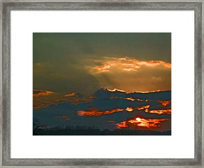 Sun Peering Through The Clouds Framed Print