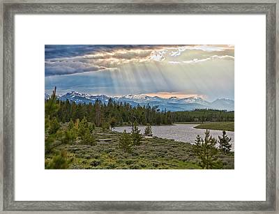 Sun Rays Filtering Through Clouds Framed Print