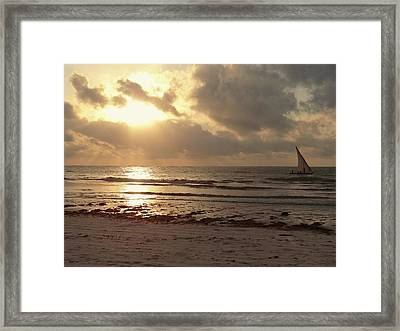 Sun Rays On The Water With Wooden Dhow Framed Print