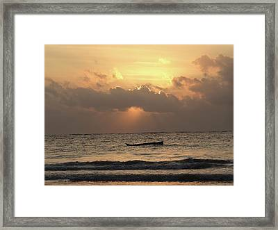 Sun Rays On The Water With Wooden Dhows Framed Print