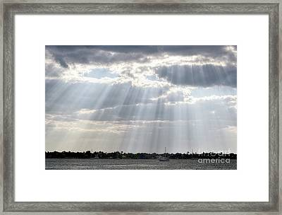 Sun Rays Over Lagoon Framed Print