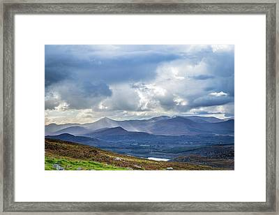 Framed Print featuring the photograph Sun Rays Piercing Through The Clouds Touching The Irish Landscap by Semmick Photo