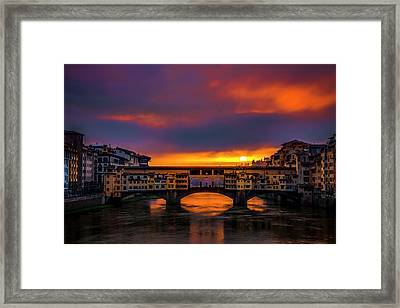 Sun Rises Over The Ponte Vecchio Framed Print by Andrew Soundarajan