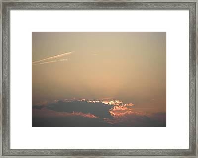 Sun Setting Behind The Clouds Framed Print