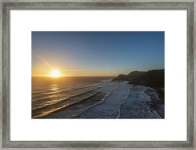 Sun Setting Along The Oregon Coast Framed Print by Remsberg Inc