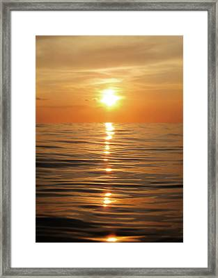 Sun Setting Over Calm Waters Framed Print