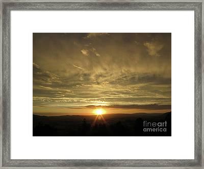 Sun Setting Over The Horizon Framed Print