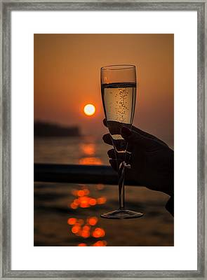 Sun Setting Through A Glass Of Champagne Framed Print by Jon Ingall