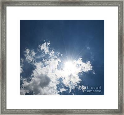 Sun Through The Clouds Framed Print by Reva Steenbergen