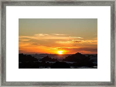 Sundown Surf Framed Print by Juan Romagosa