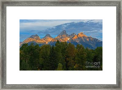 Sundrise On Grand Tetons Framed Print by Sharon Seaward