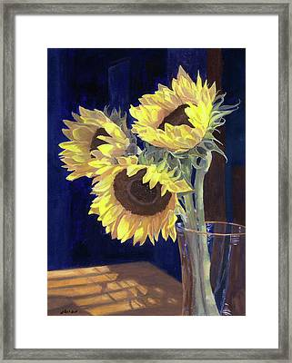 Sunflowers And Light Framed Print by Lynne Reichhart