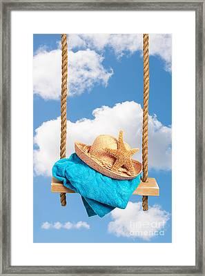Sunhat On Swing Framed Print