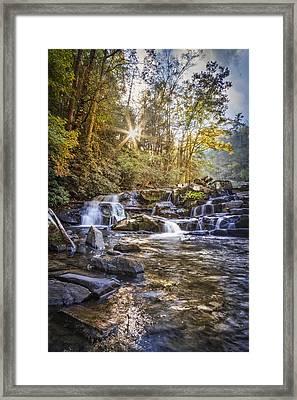 Sunlight At The Falls Framed Print by Debra and Dave Vanderlaan