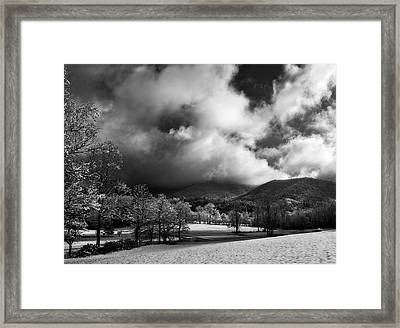 Sunlight Clouds And Snow In Black And White Framed Print