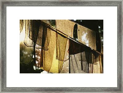 Sunlight Filters Through Prayer Flags Framed Print by Michael Melford