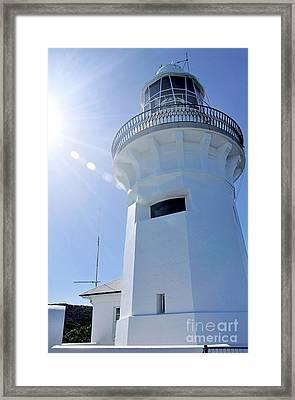 Sunlight On Lighthouse Framed Print