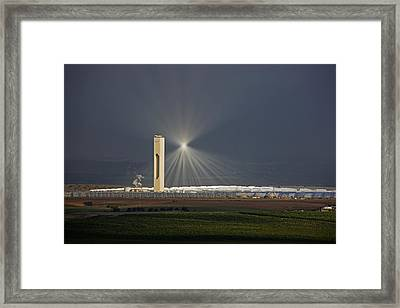 Sunlight Reflects Off Of Low Clouds Framed Print by Michael Melford