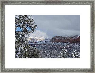 Framed Print featuring the photograph Sunlit Snowy Cliff by Laura Pratt