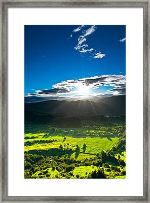 Sunrays Flood Farmland During Sunset Framed Print
