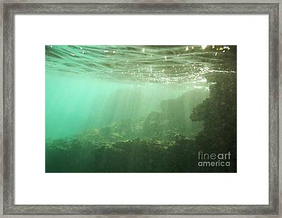 Sunrays Penetrating Underwater Cave Framed Print by Sami Sarkis