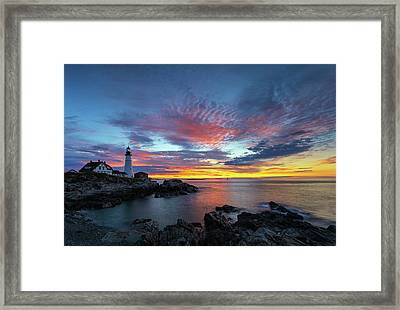 Framed Print featuring the photograph Sunrise At Portland Head Light by Juergen Roth