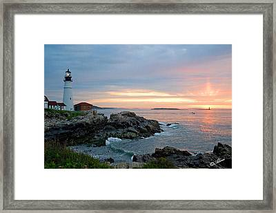 Framed Print featuring the photograph Sunrise At Portland Head Lighthouse by Alana Ranney