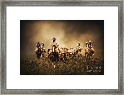 Sunrise Cattle Drive Framed Print by Priscilla Burgers