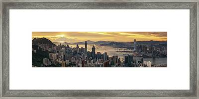 Sunrise Day To Night Shot Over Victoria Harbor  Framed Print by Anek Suwannaphoom