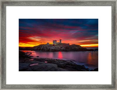 Sunrise Over Nubble Light Framed Print by Darren  White