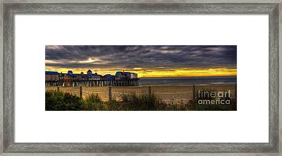 Sunrise Over The Empty Beach Framed Print by David Bishop