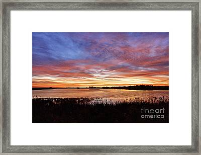 Framed Print featuring the photograph Sunrise Over The Marsh by Larry Ricker