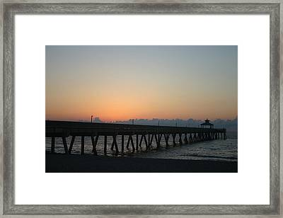 Sunrise Pier Framed Print by Dennis Curry
