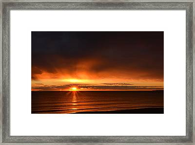 Sunrise Rays Framed Print by Nancy Landry