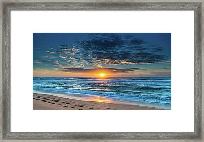 Sunrise Seascape With Footprints In The Sand Framed Print