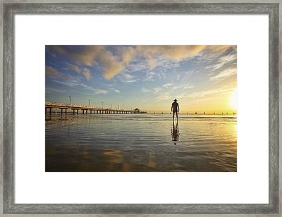 Sunrise Silhouette Down By The Pier. Framed Print