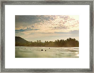 Sunrise Surfers Framed Print