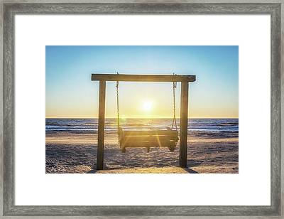 Sunrise Swings Framed Print