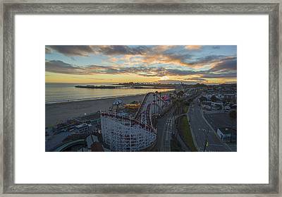 Sunset Amusement Framed Print by David Levy
